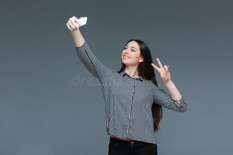 Smiling businesswoman making selfie photo stock photo