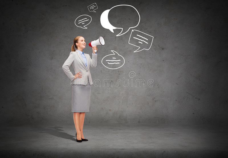 Smiling businesswoman with megaphone. Business, communication and office concept - smiling businesswoman with megaphone screaming at someone imaginary royalty free stock photos