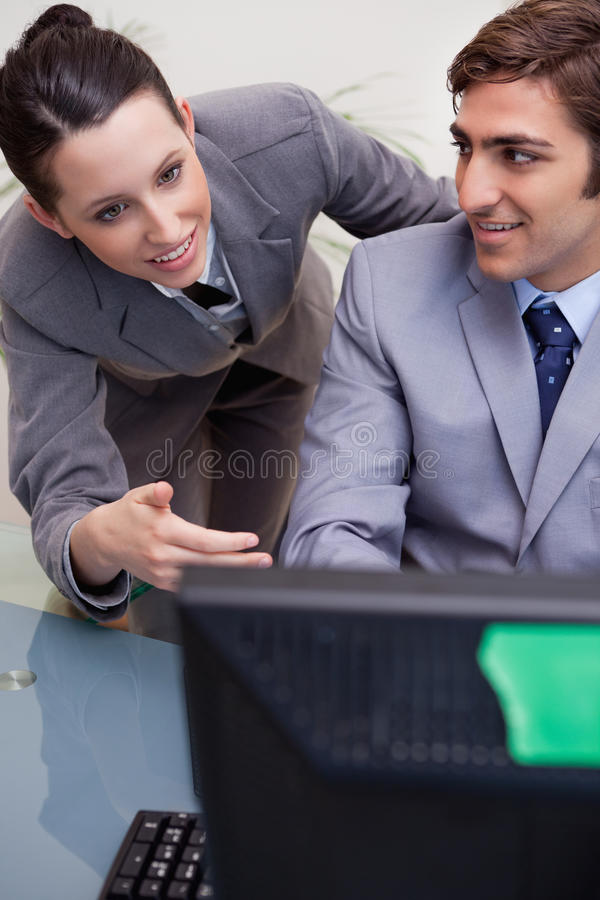 Smiling businesswoman mentoring her new colleague