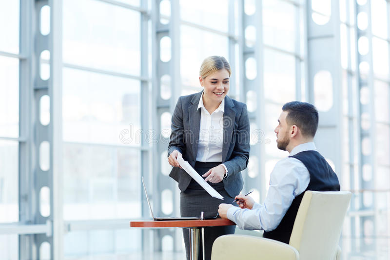 Smiling Businesswoman Presenting Contract Documentation royalty free stock image