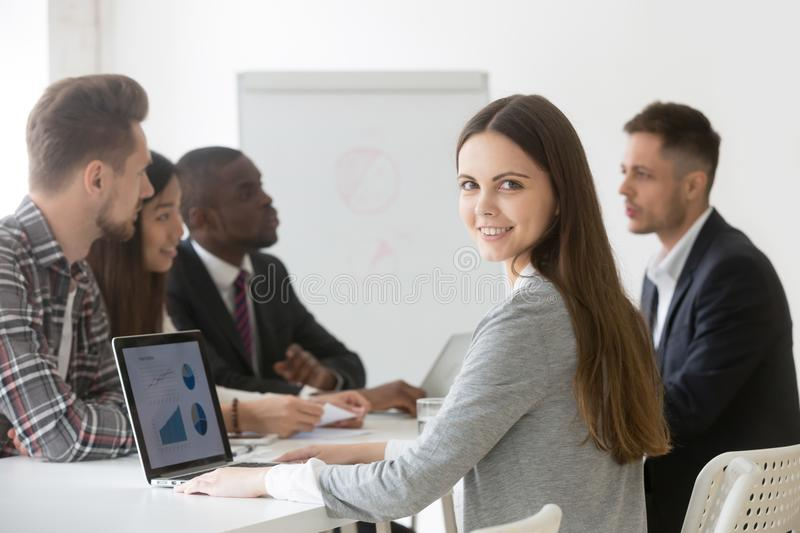 Smiling businesswoman professional or intern looking at camera a stock photography