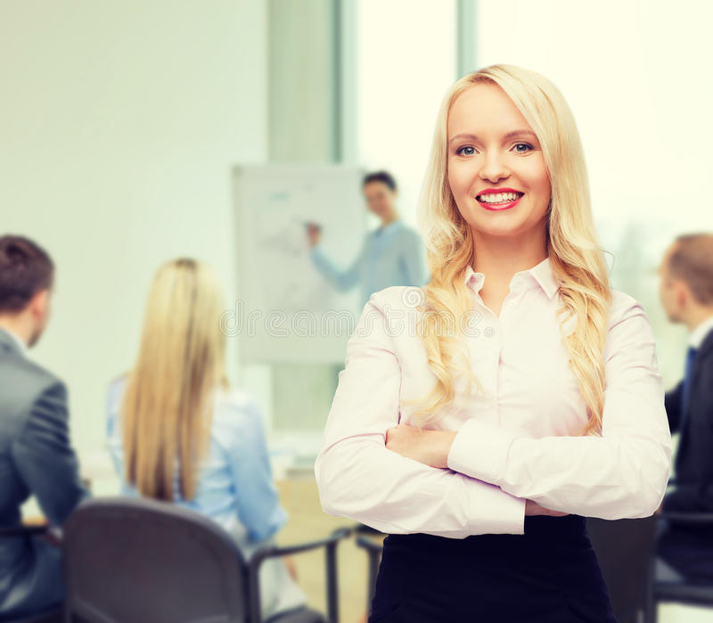 Smiling businesswoman or secretary in office stock images