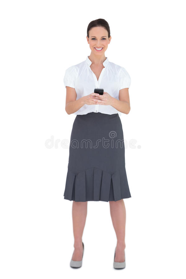 Download Smiling Businesswoman Sending A Text Message Royalty Free Stock Photography - Image: 33107857