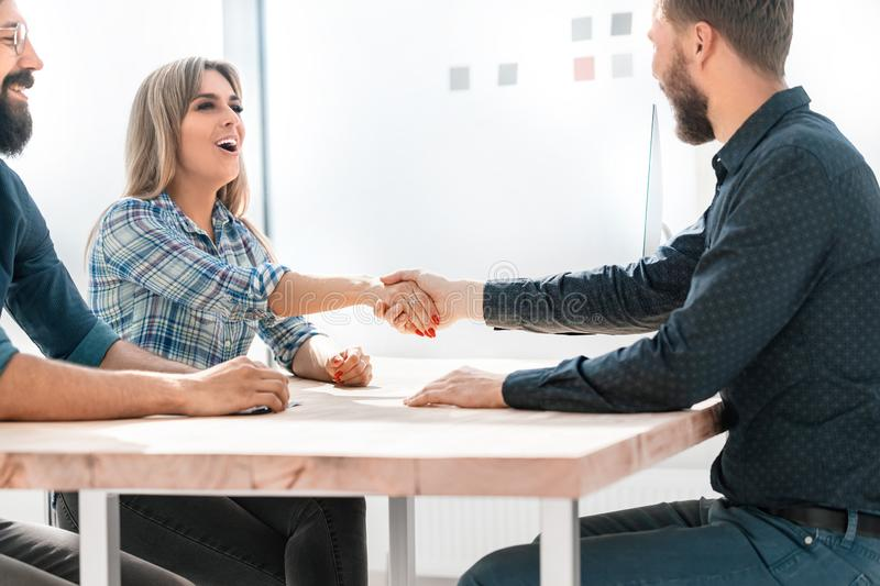 Smiling businesswoman shaking hands with her business partner. Concept of cooperation royalty free stock photo