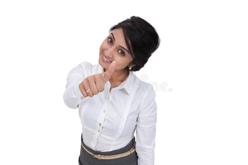 Smiling businesswoman showing thumbs up stock photo