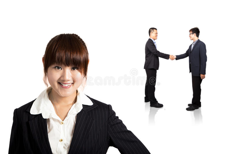 Smiling businesswoman and Successful transaction. Smiling young business woman and handshaking Successful deal stock photos