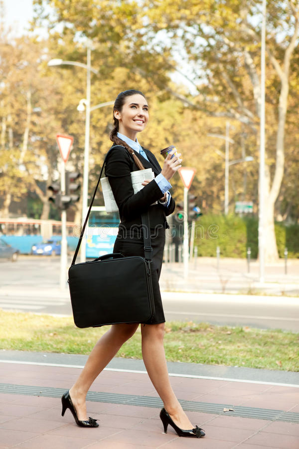 Download Smiling Businesswoman Walking Stock Photo - Image: 21969006