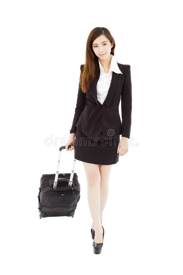 Smiling businesswoman walking and carrying the baggage stock image