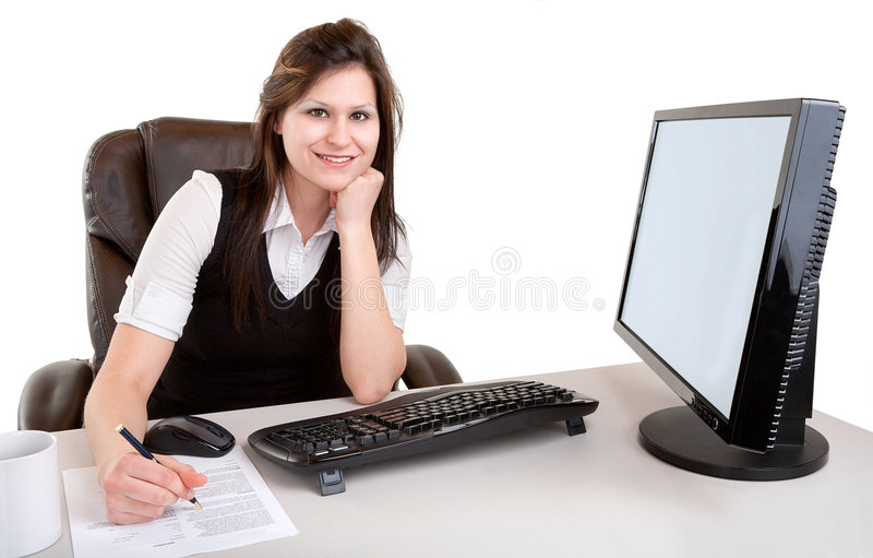 Smiling Businesswoman Working and Looking at Camer