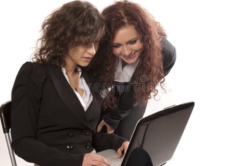 Smiling businesswomen with laptop stock photo