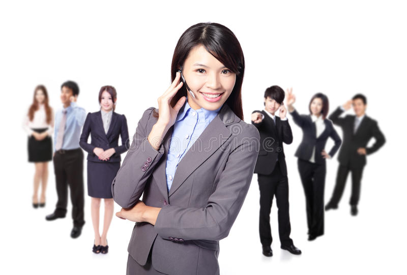 Download Smiling Call Center Executive With Colleagues Stock Image - Image: 28526553