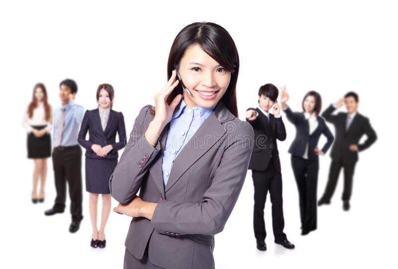 Smiling call center executive with colleagues stock photos