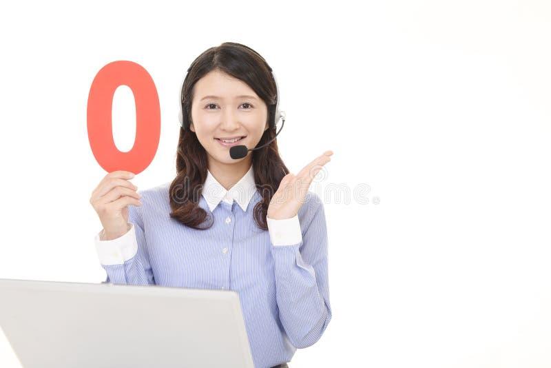 Smiling call center operator royalty free stock photos