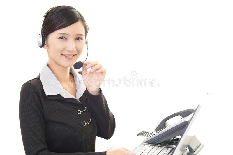 Smiling call center operator stock photo