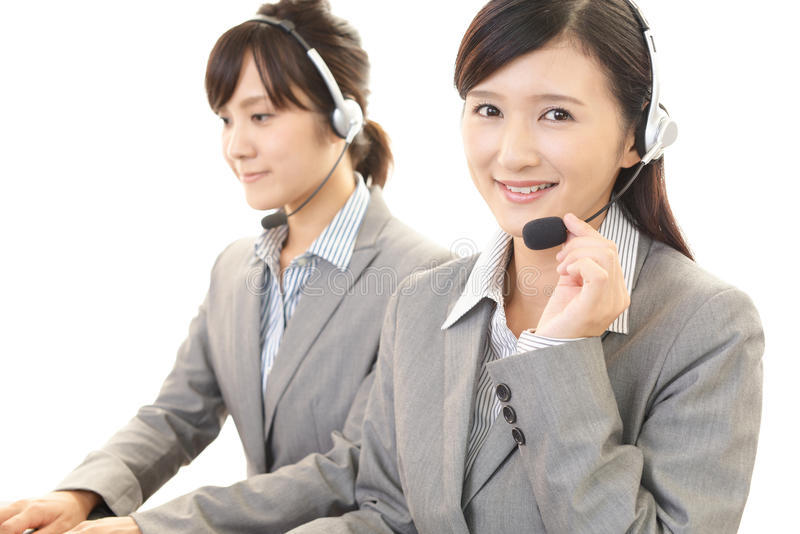 Smiling call center operators stock photography