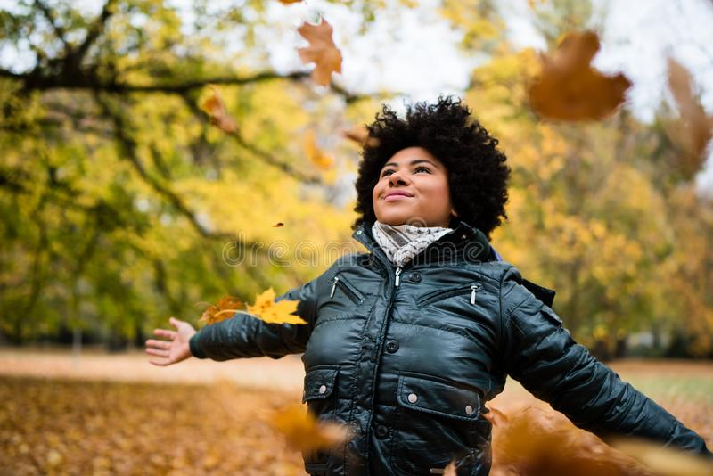 Teenager with arms widespread in fall park stock photos