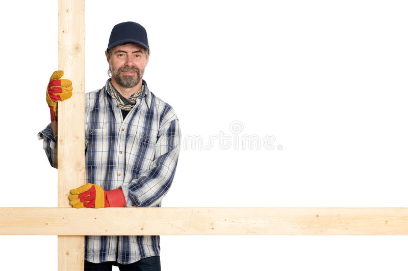 Download Smiling Carpenter Holding The Planks Stock Photo - Image: 24866940