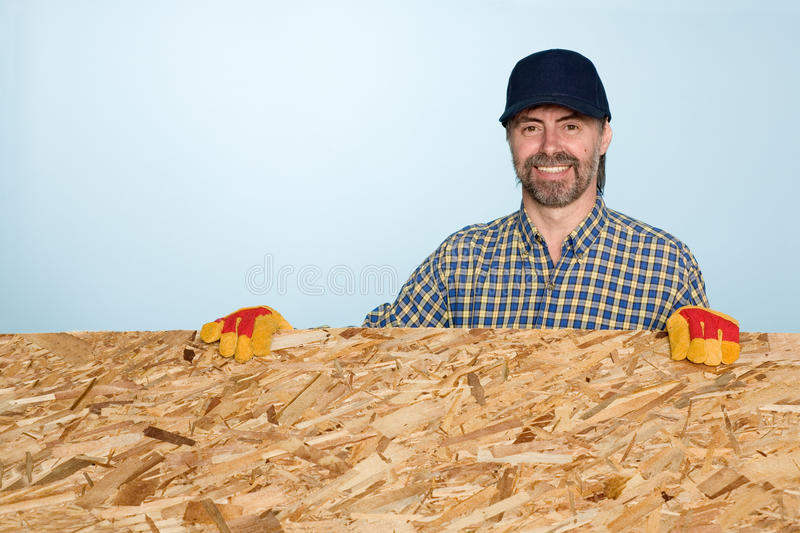Download Smiling Carpenter Holds Plywood Stock Photo - Image: 24866968
