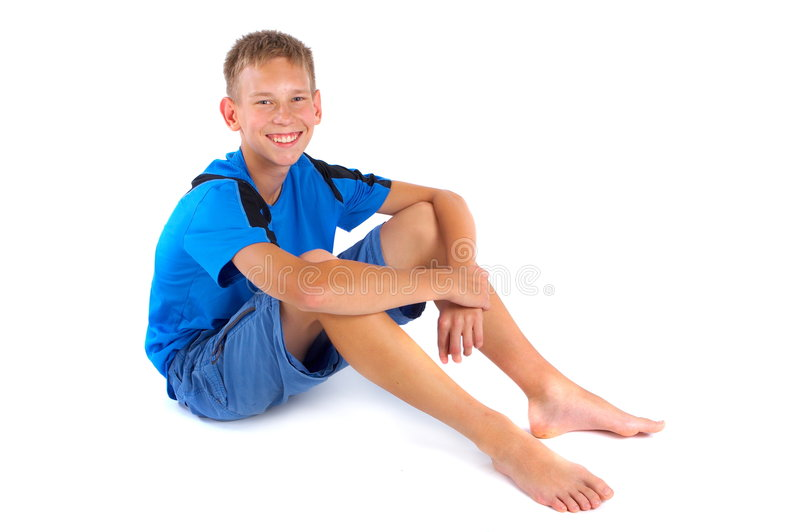 Smiling, casual boy on white stock images