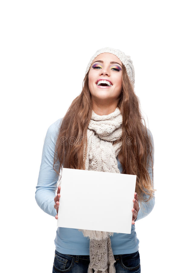 Download Smiling Casual Winter Girl Holding Sign Stock Image - Image: 27665127