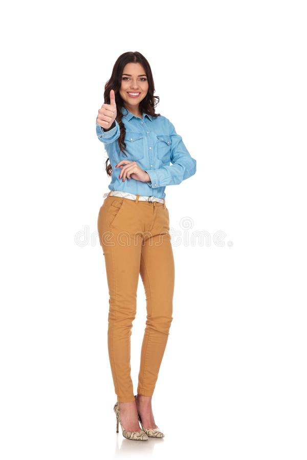 Smiling casual woman making the ok thumbs up hand sign royalty free stock photos