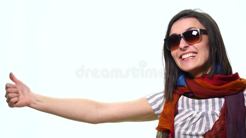 Smiling casual woman pointing finger away isolated on a white background royalty free stock photo
