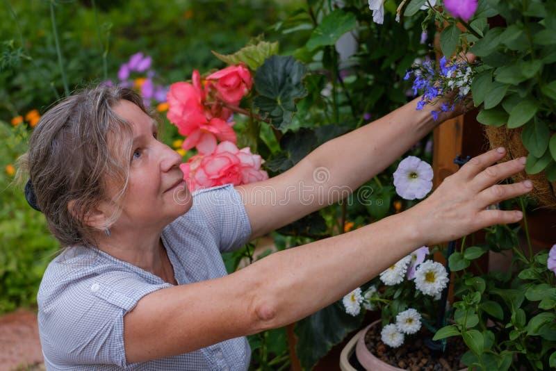 Smiling caucaisan maturehappy woman gardening royalty free stock photo