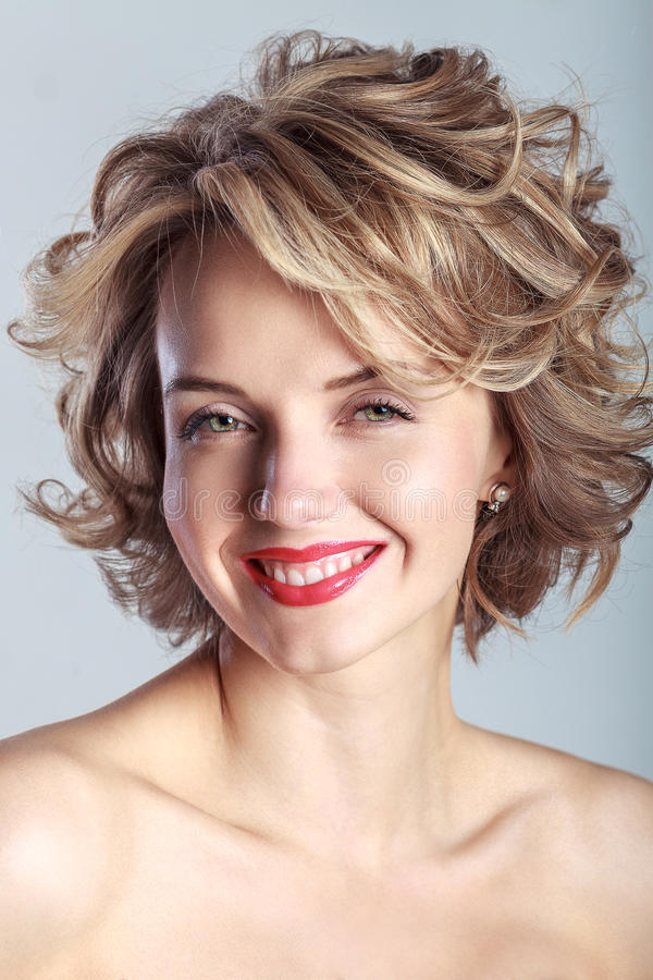 Smiling caucasian woman with curly blond hair stock photo