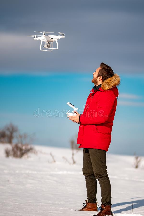 Smiling caucasian young adult flying hobby uav drone royalty free stock photo
