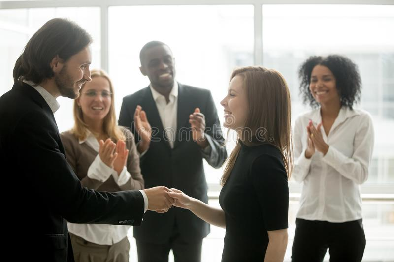 Smiling ceo handshaking successful female worker showing respect royalty free stock image