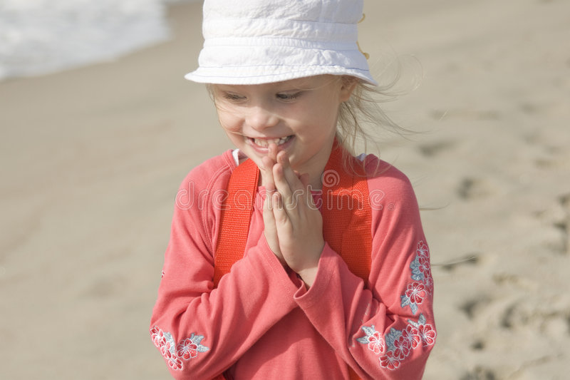 Smiling cheerful girl on the seacoast II royalty free stock image