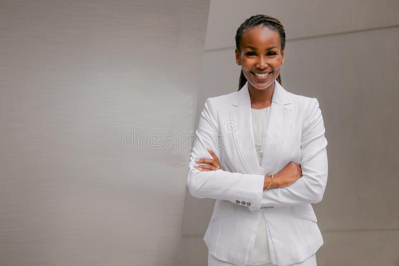 Smiling cheerful headshot portrait of an african businesswoman, corporate executive, business career professional in swanky stylis. H suit, confidently, cheerful royalty free stock image