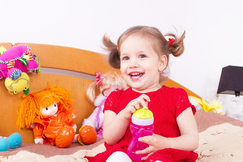 Smiling cheerful little girl royalty free stock images