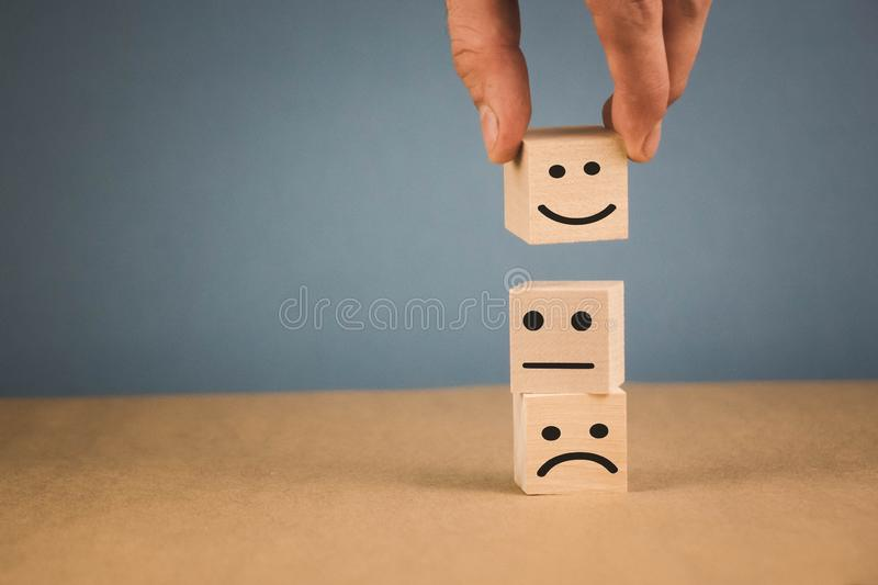smiling, cheerful and sad smile lie horizontally on top of each other stock photo