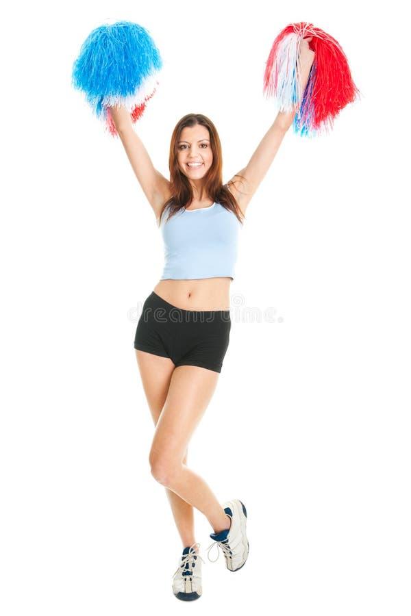 Smiling cheerleader girl posing with pom poms