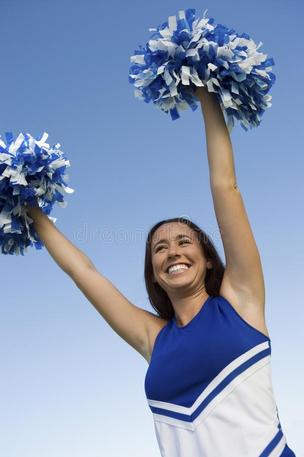 Download Smiling Cheerleader Rising Pom-poms Royalty Free Stock Images - Image: 13584659
