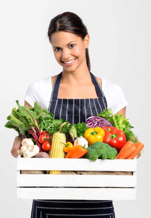Smiling chef with fresh local organic produce stock image
