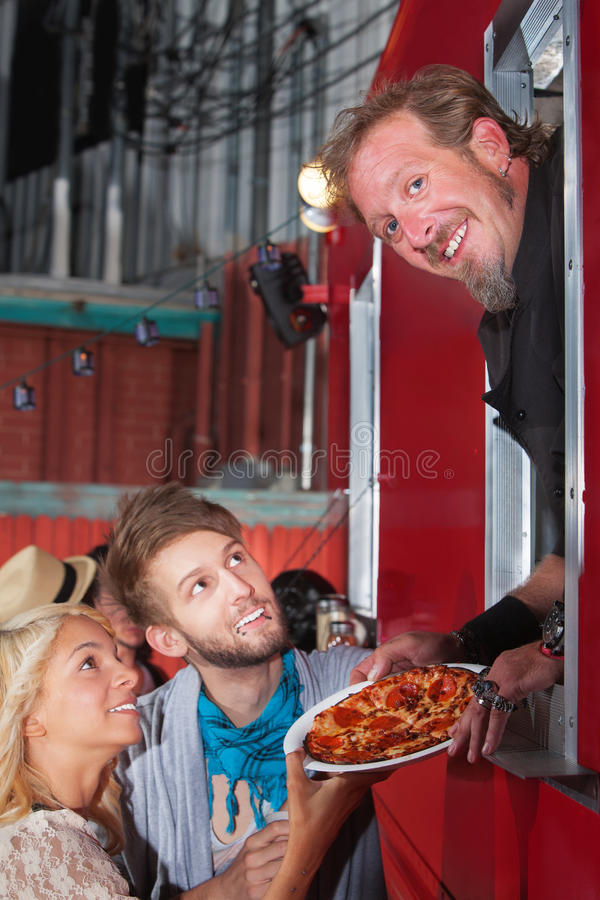 Chef with Pizza at Food Truck royalty free stock photos