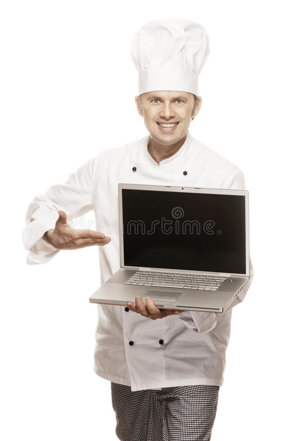 Chef serie. Smiling Chef showing the screen of a laptop, isolated on white stock image