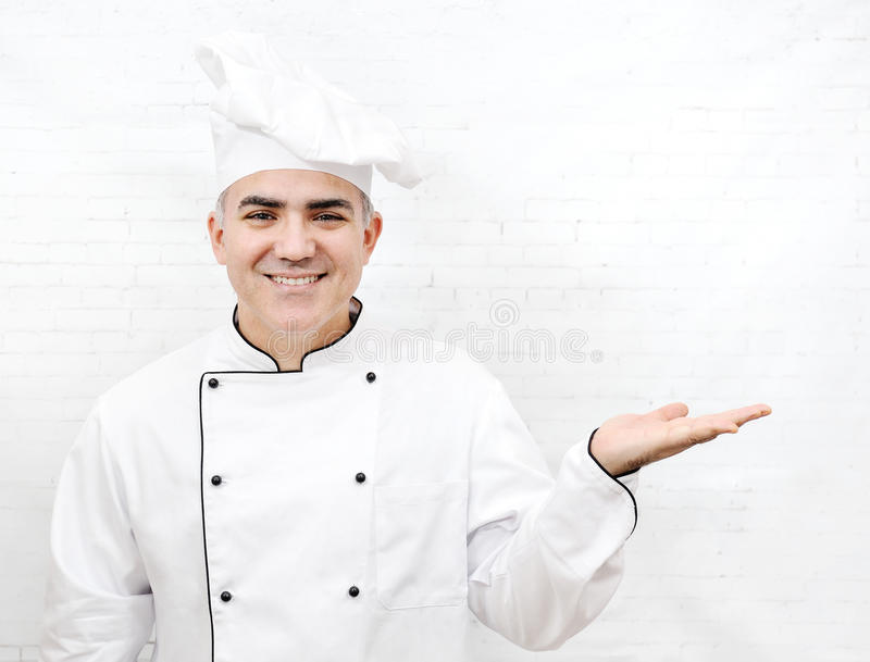 Smiling chef in white uniform stock images