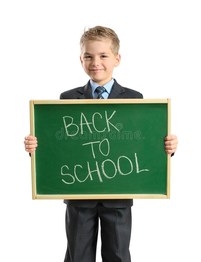 Smiling child with blackboard stock photo