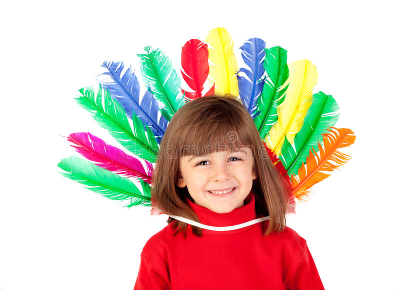Smiling child with colorfully feathers stock photos