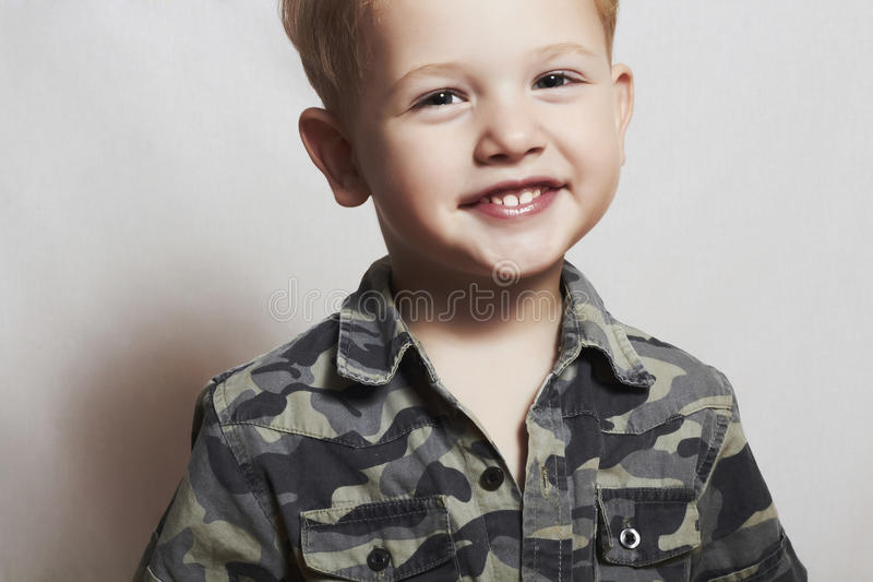 Smiling child. funny little boy. close-up. joy. 4 eyers old. military shirt royalty free stock photos