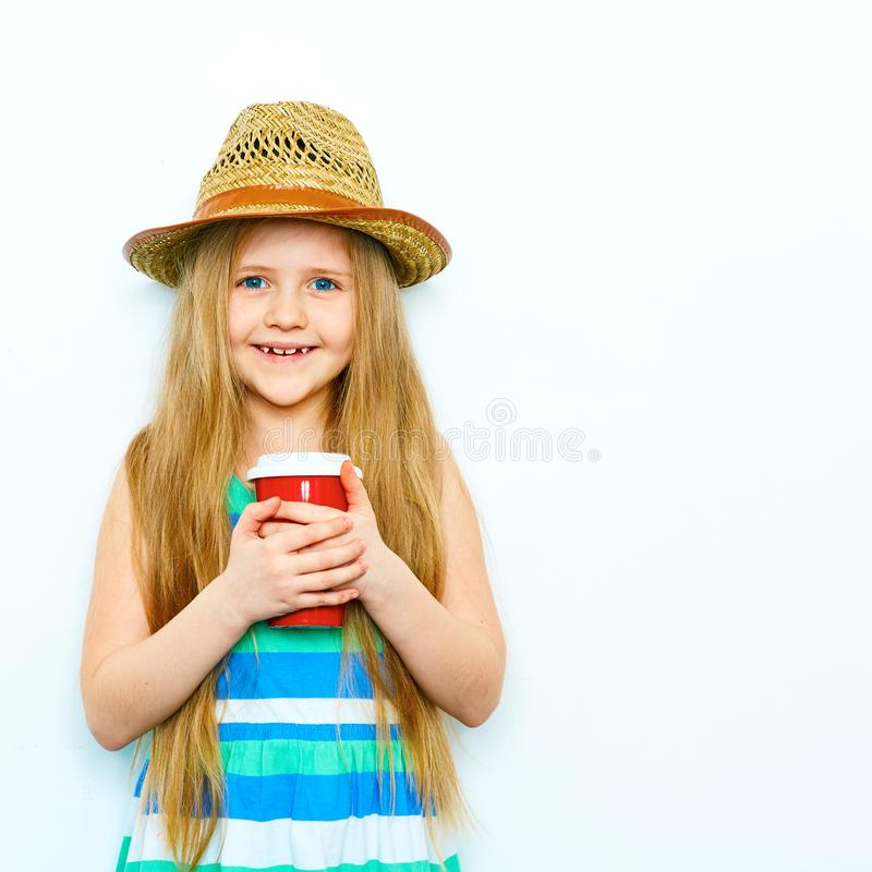 Smiling child girl in hipster style standing against white isol royalty free stock photography