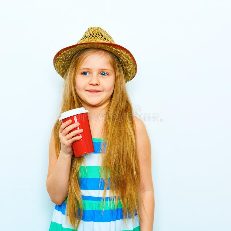 Smiling child girl in hipster style standing against white isol royalty free stock image