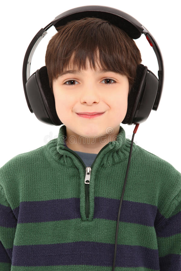 Smiling Child Headphones with Clipping Path. Young Boy Wearing A Set Of Headphones with Clipping Path over white royalty free stock photo
