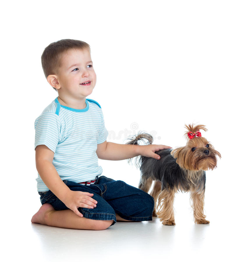 Download Smiling Child Playing With A Puppy Dog Stock Photo - Image: 28032604