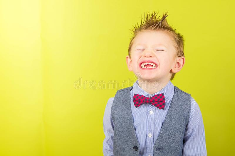 Smiling child with shirt and bow tie royalty free stock photography