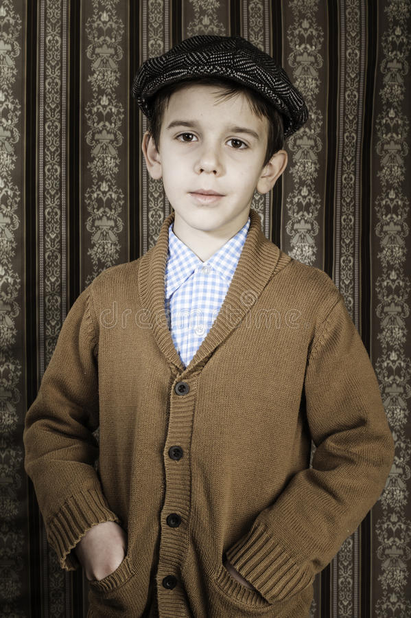 Smiling child in vintage clothes and hat stock photos