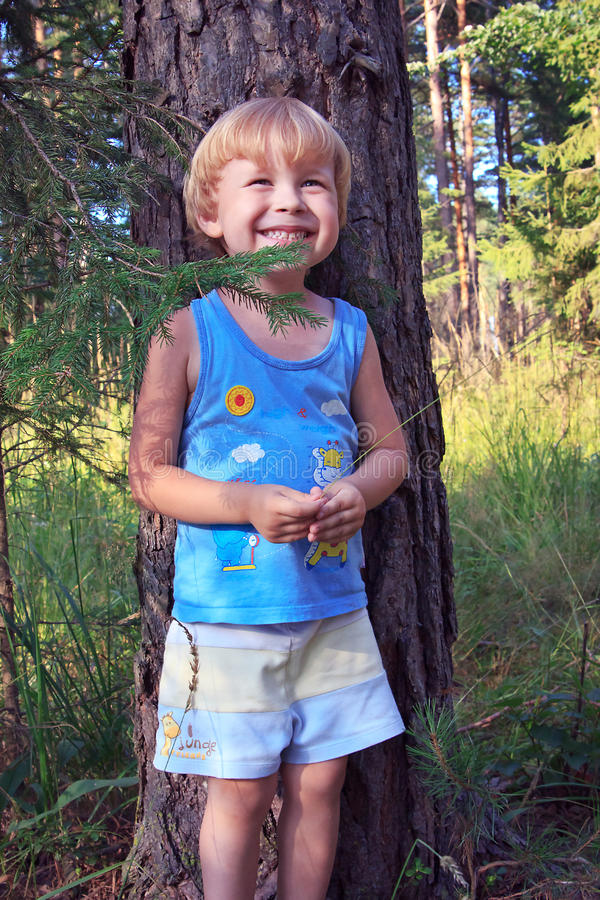 Smiling child walking in forest royalty free stock photos